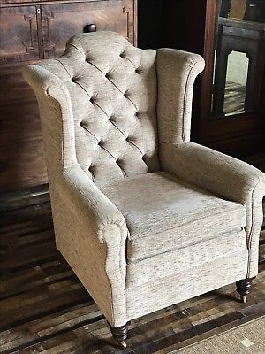 An Edwardian Button Back Upholstered Wing Back Armchair