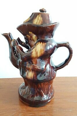 Rockingham Pottery Treacle Glazed Snuff-Taker Teapot