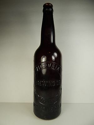 "Antique Victoria Brewing Co. Pint Bottle. 11 1/4"" Tall. Amber Red."