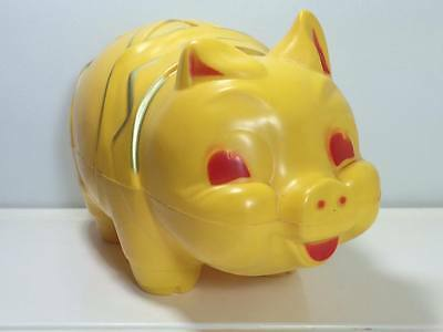 Vintage Reliable hard plastic large yellowand red  piggy bank made in Canada