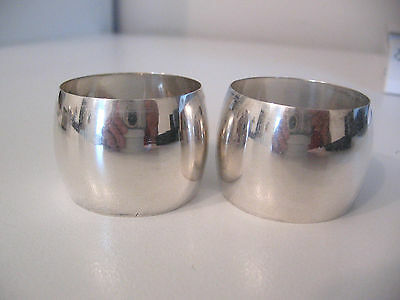 Fine pair of barrel shaped sterling silver napkin rings, no monograms.