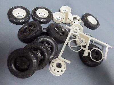 AMT unpainted ten hole budds with Goodyear tires.  1/25th scale.