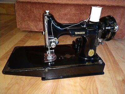 Singer Featherweight 221-1 Sewing Machine with attachments and case