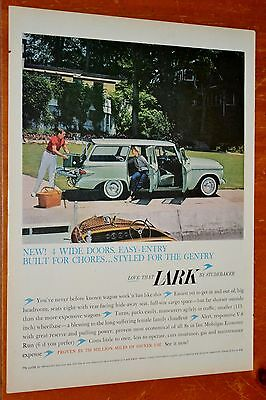 Green 1960 Studebaker Lark Station Wagon With Vintage Boat Ad / American 60S