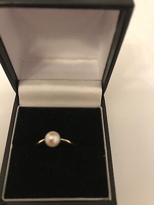 9 carot gold ring with pearl bought from John Lewis