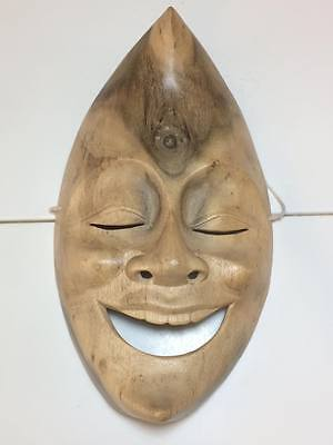 Hand carved happy moon mask from Bali