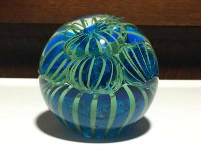 Blue and Green  art glass paperweight glows under black light