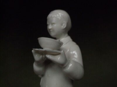Unusual Chinese Porcelain Standing Figure Holding A Bowl Of Fish