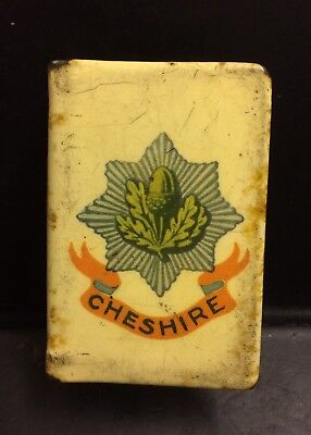 A vintage or antique matchbox cover with regimental logo, Cheshire Regiment