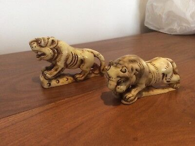 A Pair of Vintage Chinese white Hetian jade hand carvings of a 'tiger'.