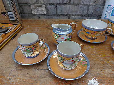 japanese hand painted porcelain cups and saucers with matching jug