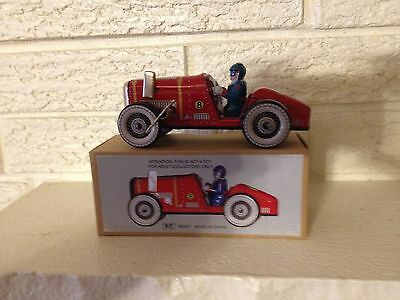 A classic old time wind-up Tin Litho Red Race Car with clockwork Mechanism NIB