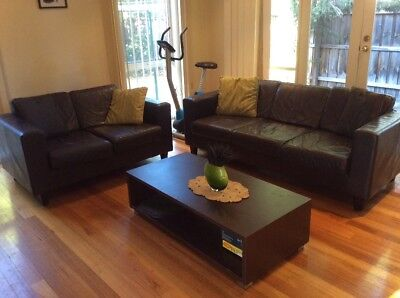 leather three and two seater couches plus coffee table