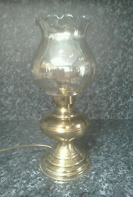 Bygone brass lamp with glass shade