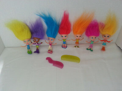 Trolls it's a hair thing collection ,lot 7 dolls & 2 combs