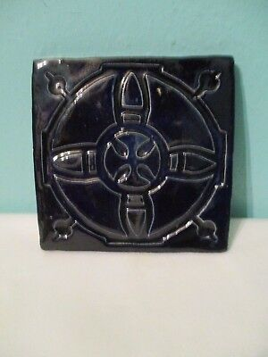 vintage thick blue ornate trivet  heavy