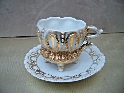 Ornate Antique Teacup & Saucer. Gilt embossed. Four footed Cup.