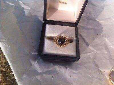 A Beautiful 9 Carat Gold Dress Ring With Red Stone
