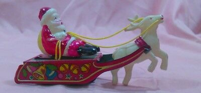 VINTAGE WIND UP COLLECTIBLE SANTA CLAUS ON SLEIGH  W/REINDEER. lot (4159)mb