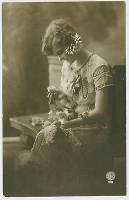 Pretty young lady / girl postcard, early 1900's