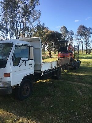 Toyota Tipper, hitachi excavator and plant trailer