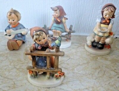 4 Hummel/Goebel figurines of girls in various situations