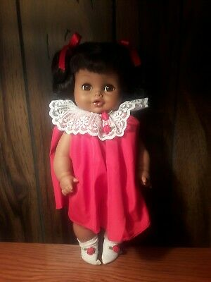 Vintage ( Horsman ) African American Doll, 12 inches with blinking eyes.