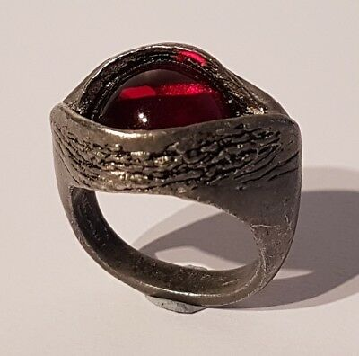 Very intriguing lead tone red eye ring.Quality made! Metal detecting find
