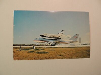 Kennedy Space Center 747 carrying the Columbia shuttle vintage postcard