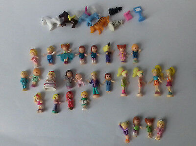 27 personnages polly pocket + quelques animaux ...