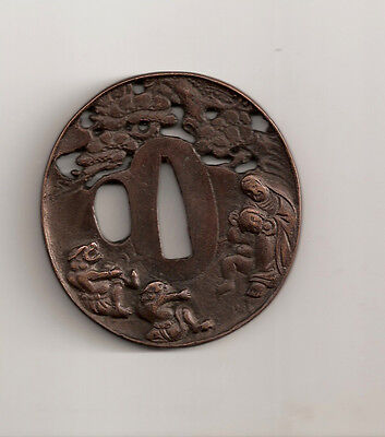 19th CENTURY JAPANESE TSUBA DEMONS IN THE FOREST