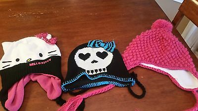 Lots of girls winter beanie hats (Hello Kitty, Monster High)