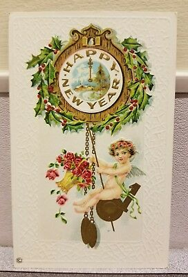 vintage new years postcard with angel and clock c1910
