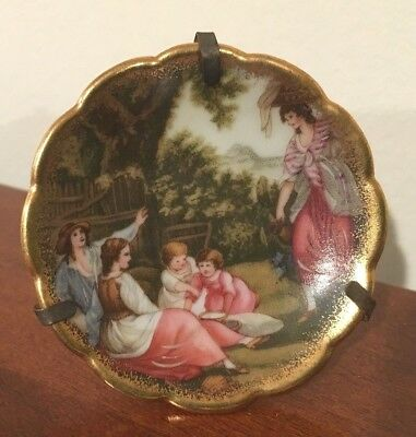 Miniature Limoge plate family in garden children playing