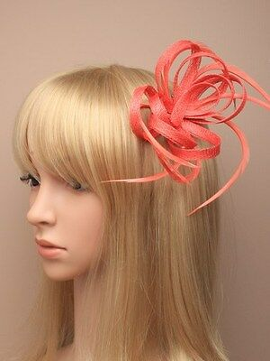 Coral looped hessian net and feather fascinator on a beak clip with brooch pin