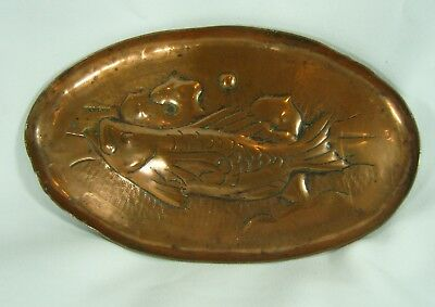 An Arts and Crafts Newlyn School Stamped Copper Pin Tray with Fish Design