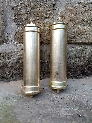 A pair of brass weights for quality longcase / grandfather clock