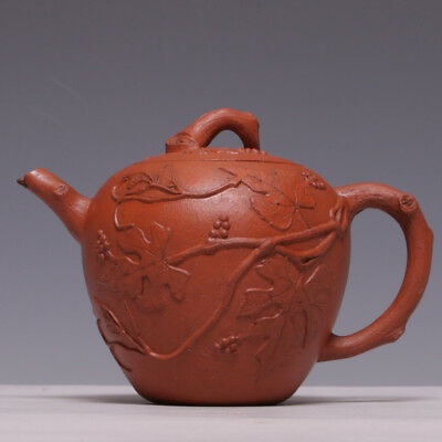 Nice Yixing red clay teapot, squirrel and grape branches, 18th century.