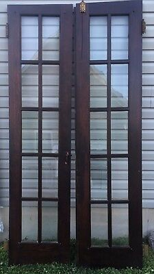 Vintage French Dark Wooden Door features 10 glass lites per door