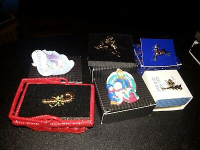 Vintage lot of 6 Holidays Avon pins in the original boxes