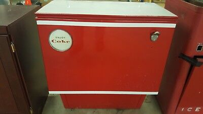 Antique Coke Machine Refurbished Coke trade mark Red and White letters.
