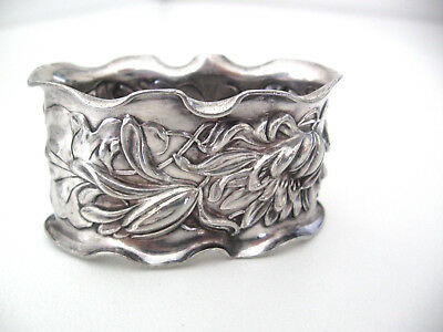 Very ornate repousse decorated silver napkin ring