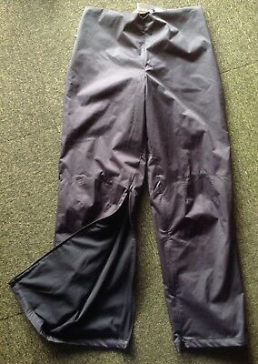 mens Nike Golf ClimaFit black size M lined all-weather polyester overpants in EC