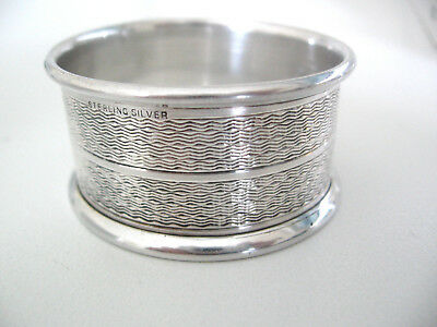 Fine engine turned sterling silver napkin ring with no monogram