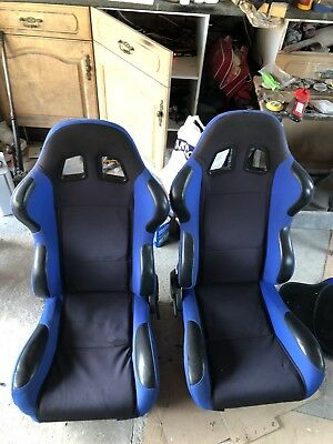 Blue Reclining Bucket Seats With Wear Protectors
