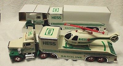 2 ~1995 Hess Truck and Helicopter, One still in original packing.