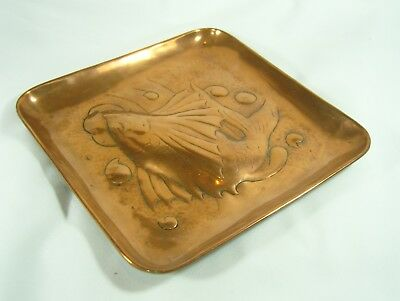 An Arts and Crafts Newlyn School Stamped Copper Tray with Fish Design
