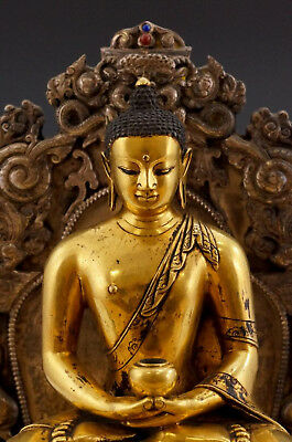 A Rare and Important Chinese Qing Gilt Bronze Buddha with Original Stand.