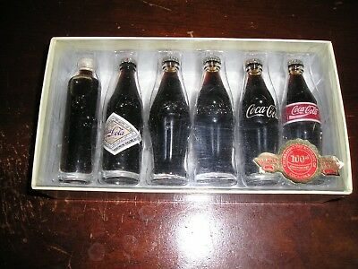 Evolution of the Coca Cola bottles from 1899 -1986, never opened.