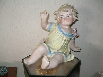 PIANO BABY, antique figurine, German bisque, porcelain, late 1800's